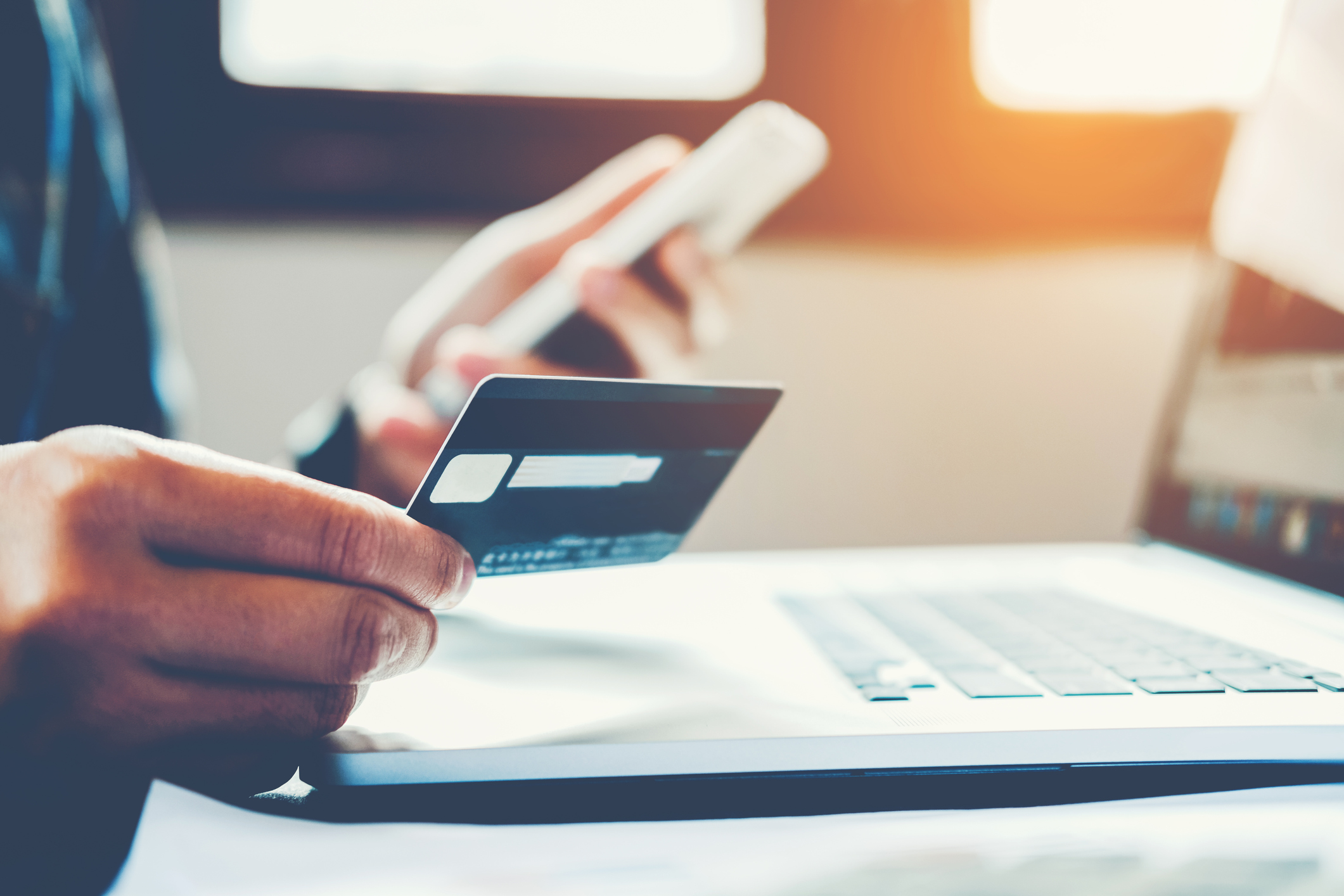 Man Holding Credit Card And Using Cell Phone holding credit card with shopping online